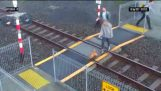 A woman enters the track right in front of an oncoming train
