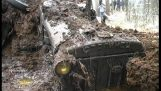 Found a WW2 tractor sunk in the mud
