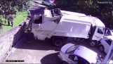 Dumpster truck falls on a parking lot