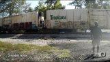 A train hits semi-trailer stuck on the railway