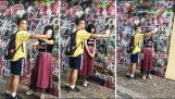 Girl uses her boyfriend as a tripod to take selfie
