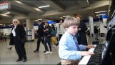 9 year old boy plays Boogie-Woogie at the London underground station