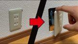 Miniature room inside a wall socket