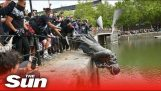 Protesters pull down a statue of Edward Colston and throw it into the river of Bristol