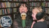 Alanis Morissette sings with her daughter in her arms