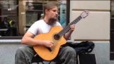 A sensational guitarist in the streets of Poland