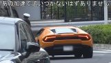 A policeman on a bike stops a Lamborghini