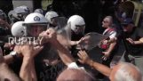 Greece: Pensioners rock police bus at Athens anti-austerity rally