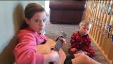 """Lydia sings to her Down Syndrome brother Bo """"you are my sunshine"""""""