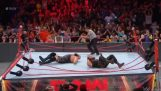 Two wrestlers dissolve the ring during a WWE match