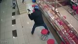 Robbers with hammers against armored jewelry showcase