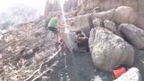 Helping a foal stuck between two rocks
