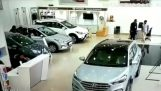Woman starts a car inside Hyundai's showroom in India