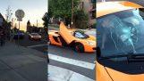 Kid breaks the windshield of a McLaren