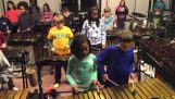 Children's percussion ensemble playing Led Zeppelin