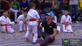 The Jean-Claude Van Damme in karate demonstration with young children