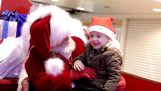 The Santa Claus speaks with a toddler in sign