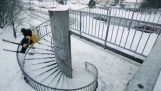 With skis on a spiral staircase
