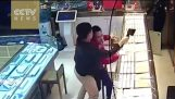 Watch: Brave employee at gold shop subdues axe-wielding robber