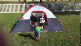 Little Boy Dominoes Topple Out of the Tent