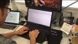Man has fun hitting giant Enter key while typing