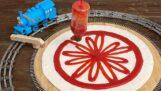 Een Rube Goldberg-machine die pizza maakt