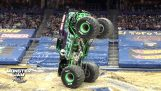Guide balances a Monster Truck on two wheels