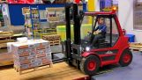 Operator forklift in a miniature storage