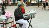 Patlamış mısır şarkı : Bir Sokak icracı tarafından gözlüklerle Müzik