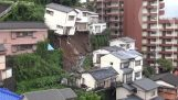 House crashes down hill after Japanese mudslide
