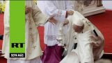 Pope Francis falls during a Mass in Poland