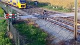 Biker escapes briefly from train at railway crossing