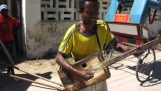 A musician from Madagascar plays an improvised guitar