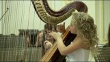 Of 9- harpist enchants with her music