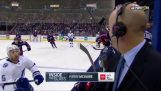 Hockey puck scrapes the head of a commentator