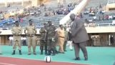 The sports minister of Uganda kicking a ball