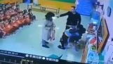 Furious father attacking teacher who hit his child (China)