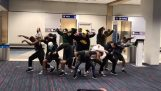 Dancers entertain passengers, where the flight is delayed for 6 hours