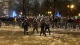 Russian protesters attack police with snowballs