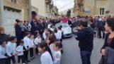 Children pulling a priest in a Porsche (Malta)